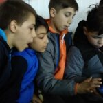 boys working on tablet - online learning