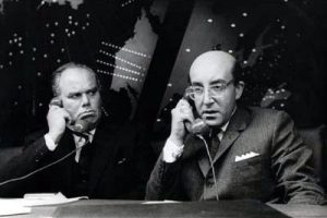 Peter Sellers as Dr Strangelove, holding a telephone, talking to his Russian counterpart